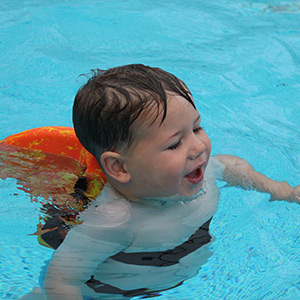 Child Using SwimFin Children's Swimming Aid in Pool