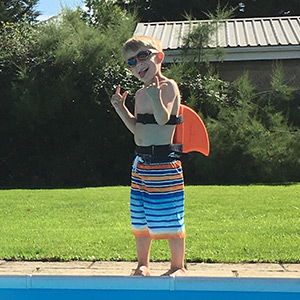 Child wearing SwimFin Swimming Aid at Poolside