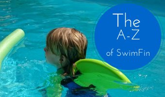 SwimFin Child in Water With Green Fin Swimming Aid